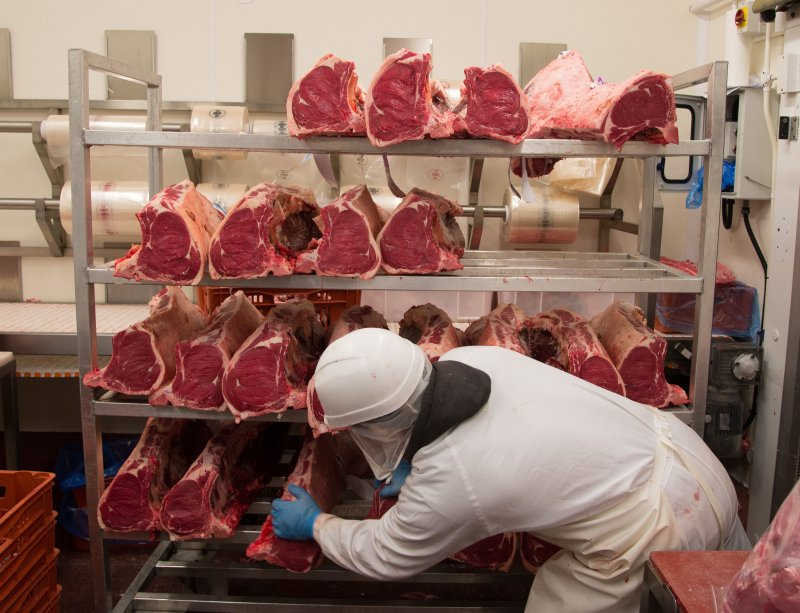 Hundreds of workers have tested positive for Covid-19 at meat processing plants and abattoirs in the UK