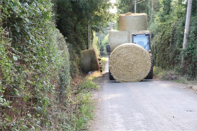 The farm worker failed to properly secure a load of straw bales